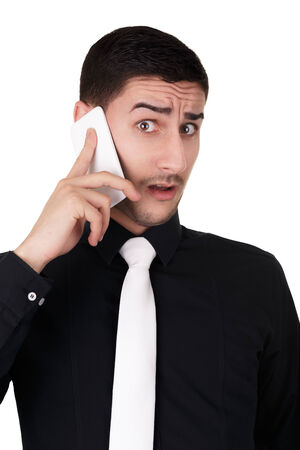 Young Businessman with Surprised Expression on the Phone