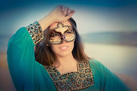 Glamour portrait with mask photo