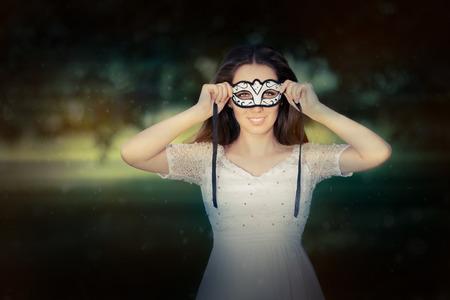 Portrait of a woman preparing for a masquerade ball photo