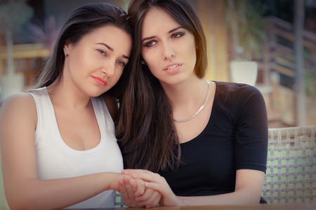 bff: Young woman consoling her best friend Stock Photo