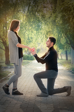 Man proposing marriage with a romantic gesture