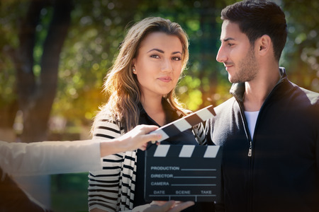 role models: Young couple shooting a romantic scene outside Stock Photo