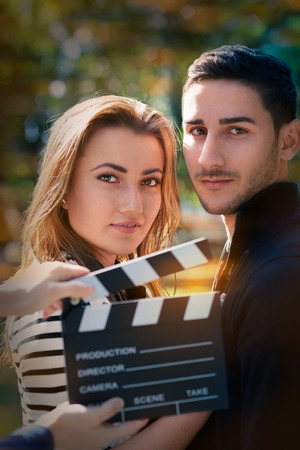 movie star: Young couple shooting a romantic scene outside Stock Photo