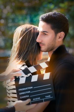 outside shooting: Young couple shooting a romantic scene outside Stock Photo