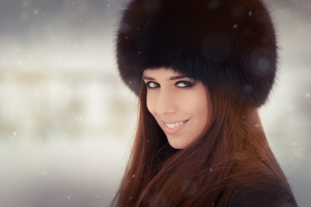 Stylish woman in wintertime headshot photo