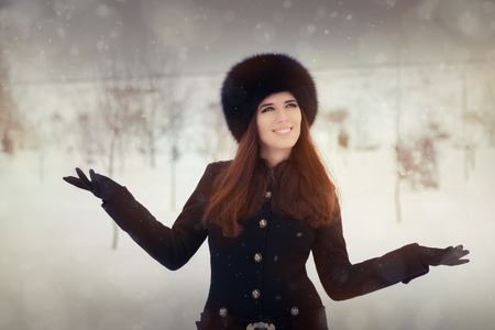 Beautiful stylish woman outside in the cold photo