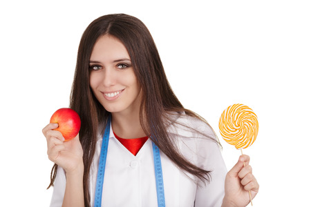 guilty pleasures: Woman nutritionist comparing healthy and unhealthy dessert options, isolated on white background.