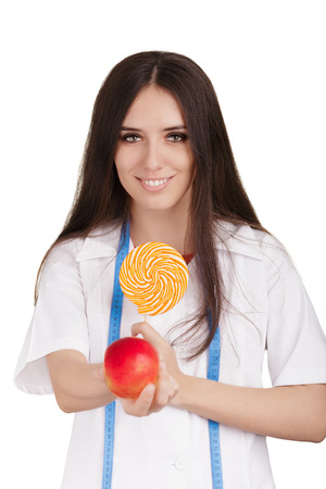 guilty pleasure: Woman nutritionist comparing healthy and unhealthy dessert options, isolated on white background.