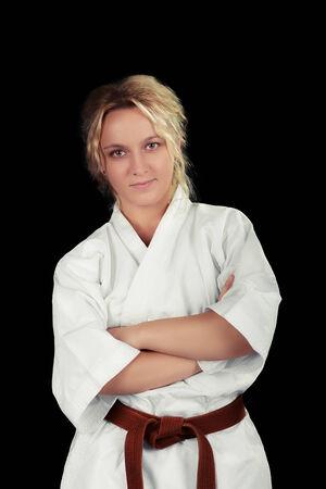 defensive posture: Portrait of a young beautiful martial arts girl in kimono
