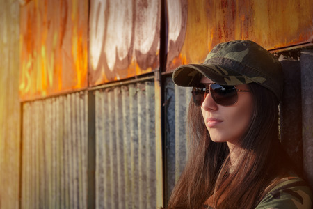 american field service: Portrait of a tough beautiful female army soldier Stock Photo