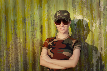sergeant: Portrait of a happy beautiful female army soldier