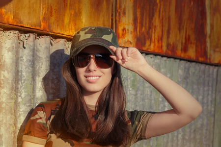 army girl: Portrait of a happy beautiful female army soldier