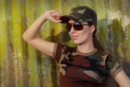 american field service: Portrait of a happy beautiful female army soldier