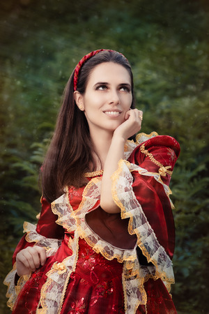 Portrait of a happy beautiful Renaissance queen in red royal dress