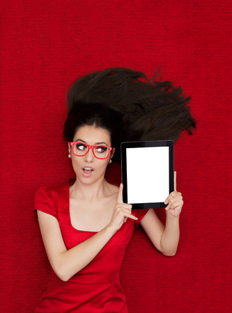 promoter: Beautiful amazed woman in red decor holding a tablet PC