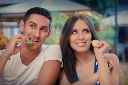 Young couple eating French macaron dessert Stock fotó - 35604458
