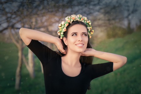 myth: Portrait of a beautiful young woman outside wearing a floral headdress Stock Photo
