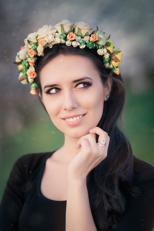Close-up of a beautiful young woman outside wearing a floral headdress photo