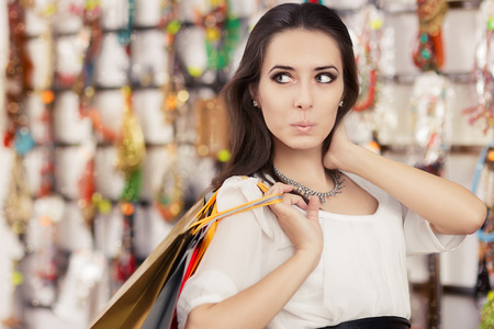 spender: Portrait of an amazed young girl with shopping bags in trendy store Stock Photo