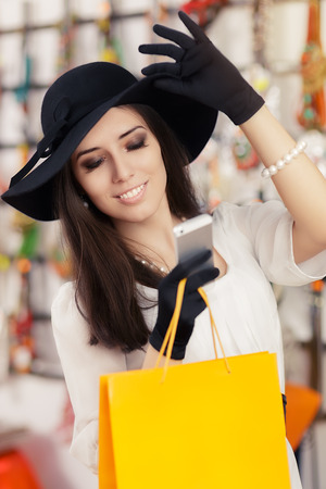 Portrait of a young elegant girl with shopping bags and Smartphone photo