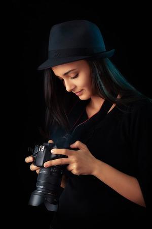 dslr camera: Portrait of a cool girl holding a DSLR camera