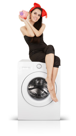 low energy: Young housewife doing laundry and saving money