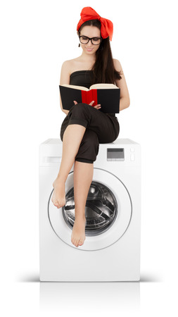 clothes pin: Young housewife doing laundry and reading Stock Photo