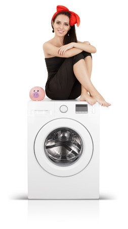 tidying up: Young housewife doing laundry and saving money
