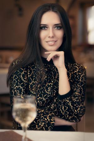 Portrait of an elegant woman in a fancy restaurant photo