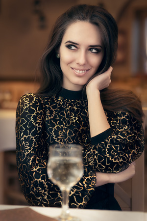 romantic evening with wine: Portrait of an elegant woman in a fancy restaurant Stock Photo