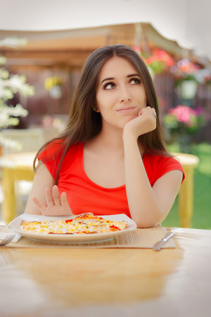 self conscious: Young Woman Refusing  To Eat a Pizza Stock Photo