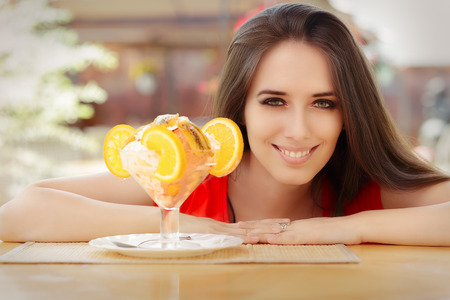 Happy Young Woman and Summer Dessert photo