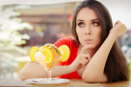 deciding: Young Woman Deciding to Eat a Summer Desert Stock Photo