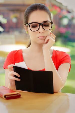 pricey: Sad Woman Checking Restaurant Bill