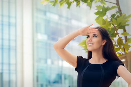 Young Businesswoman Looking Up  and Searching for Something photo