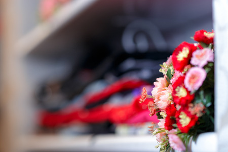 Flower Bouquet on Clothing Shelf