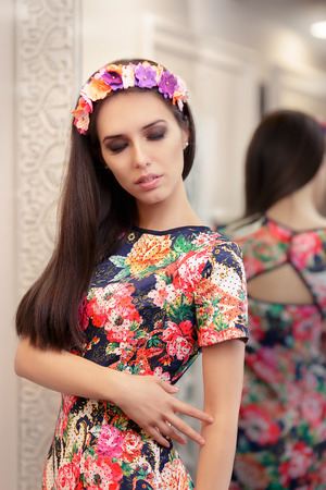 Beautiful Girl Trying on Floral Dress photo