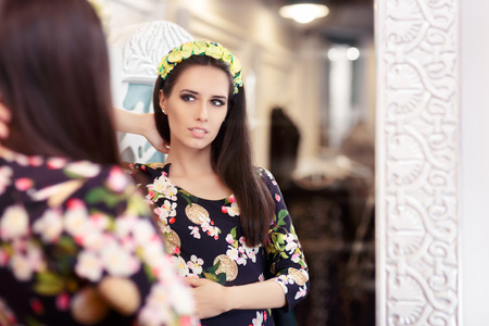 changing colors: Beautiful Girl Looking in the Mirror and Trying on Floral Dress