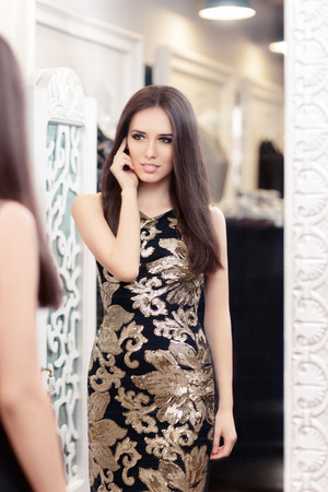 changing colors: Beautiful Girl Looking in the Mirror and Trying on an Elegant Dress