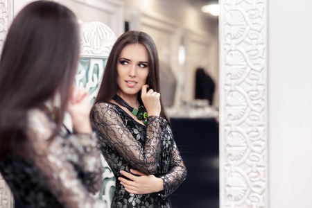 formal dressing: Beautiful Girl in Black Lace Dress Looking in the Mirror