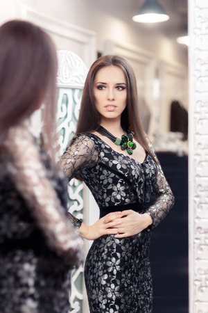 new look: Beautiful Girl in Black Lace Dress Looking in the Mirror