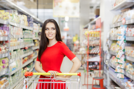 shopping buggy: Happy Woman Shopping  at The Supermarket Stock Photo