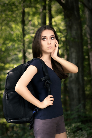 sort out: Disoriented Hiking Girl with Travel Backpack