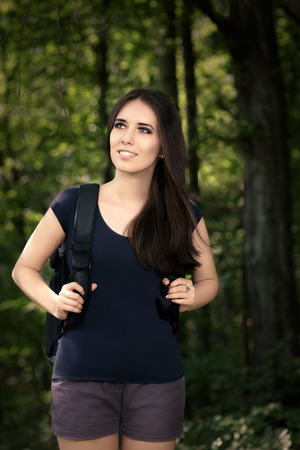 sort out: Happy Hiking Girl with Travel Backpack Stock Photo