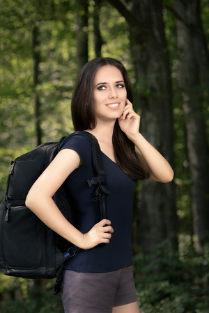 Happy Hiking Girl with Travel Backpack photo