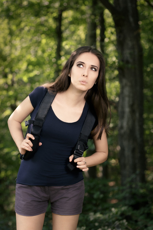 Disoriented Hiking Girl with Travel Backpack photo