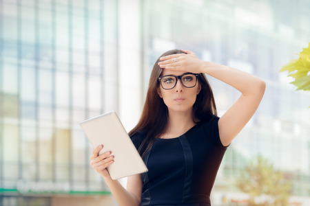Young Woman with Tablet Having an Idea photo