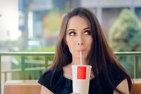 energy drink: Young Woman Having a Summer Refreshing Drink Outside