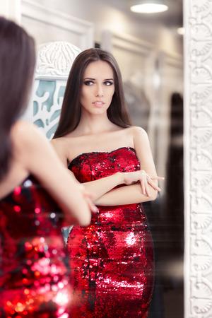 sequin: Beautiful Girl in Red Sequin Dress Looking in the Mirror