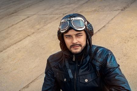 adventure aeronautical: Retro Pilot Portrait with Glasses and Vintage Helmet